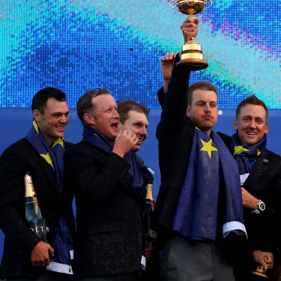 AUCHTERARDER, SCOTLAND - SEPTEMBER 28: Henrik Stenson lifts the trophy as Europe team captain Paul McGinley celebrates winning the Ryder Cup with his team after the Singles Matches of the 2014 Ryder Cup on the PGA Centenary course at the Gleneagles Hotel on September 28, 2014 in Auchterarder, Scotland.  (Photo by Mike Ehrmann/Getty Images)
