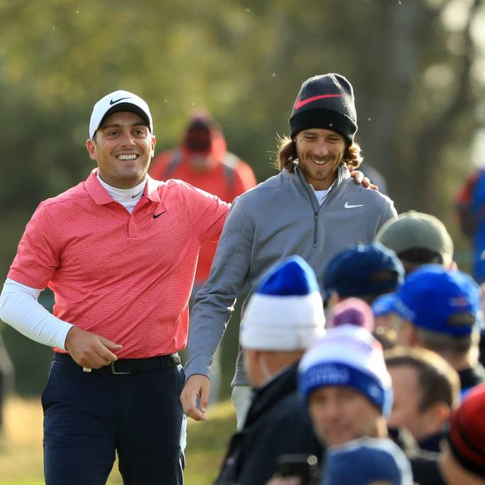 TADWORTH, ENGLAND - OCTOBER 12:  Tommy Fleetwood of England and Francesco Molinari of Italy share a joke when walking off the 15th hole during Day Two of Sky Sports British Masters at Walton Heath Golf Club on October 12, 2018 in Tadworth, England.  (Photo by Andrew Redington/Getty Images)